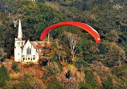 A paraglider flies above Kalimpong. File picture