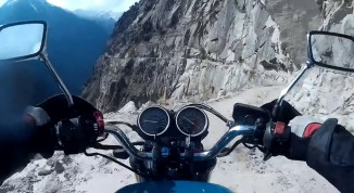 Man Riding Motorcycle on mountain